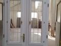 Fa ajtó, ablak gyártás, csere - Fa bejárati ajtó fehér a műhelyben